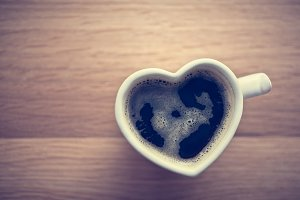 Coffee in heart shaped cup.