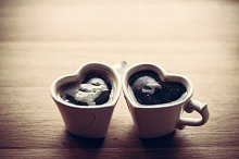 Black coffee in heart shaped cups.