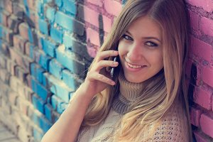 blonde woman talking over phone