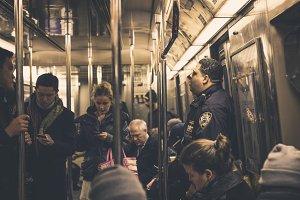 Cop on Subway