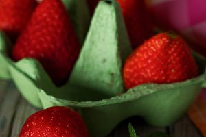 Red strawberry with mint leaves