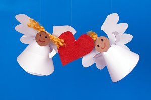 two toy angels and heart