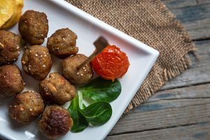 Fried meatballs and sliced potato