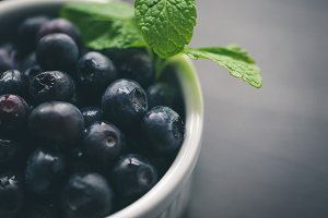 Bowl of berries with sprig of mint