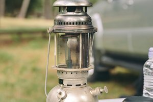 Oil lamp over camping table
