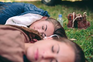 Women resting in sleeping bags