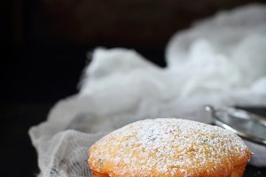 Orange muffin with powdered sugar