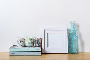 A small white picture frame on desk