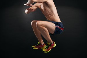 man jumping on black background