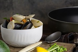 Seafood in bowl, rustic table