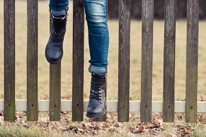 legs girl sitting on a fence
