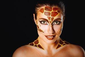 Girl with make-up giraffe