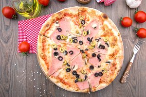 Italian pizza with ham olives