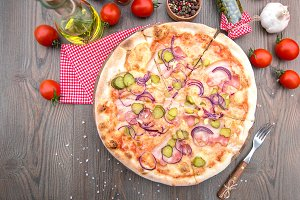 Italian pizza with ham pickles