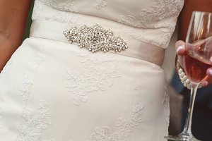 bride detail, with sparkling wine