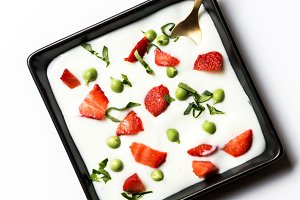 Peas and sliced strawberry in cream