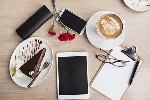 Flat lay desk with coffee and cake