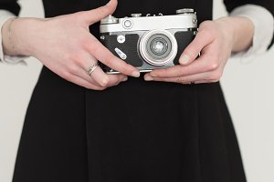 girl holding an old camera
