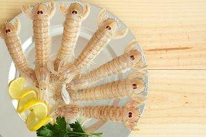 Uncooked seafood platter garnished