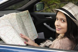 girl in the car with the map