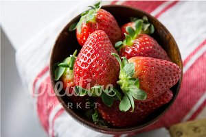 Strawberries in wooden bowl