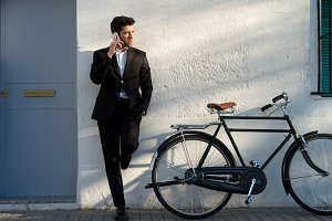 businessman with bicycle & telephone