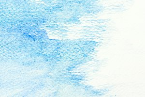 Blue watercolor paint on canvas.