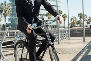 businessman in vintage bike