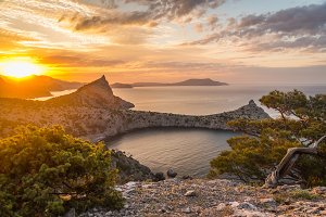 Seascape at sunrise in the mountains