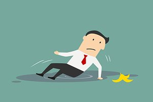 Businessman slipped on a banana