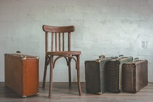 Old suitcase and a wooden chair