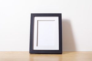 Small black picture frame on desk