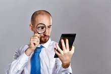 Businessman looking magnifying glass
