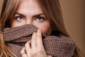 Girl hide face in warm sweater