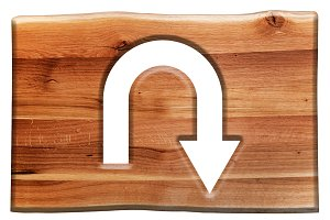 U-turn sign cut in wooden board.