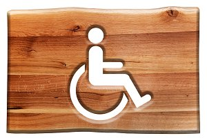 Man on wheelchair - sign in wood.