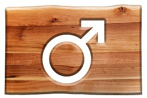 Male symbol cut in wooden board.