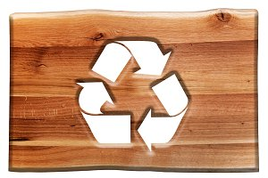 Recycling sign in wooden board.