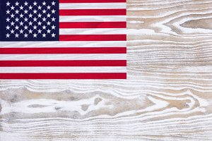 USA flag on faded white wood