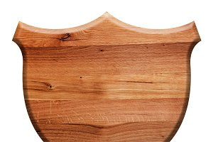 Wooden shield isolated on white.