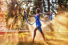 Ballerina dancing in spray of water