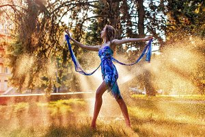 Ballerina dancing in spray of water