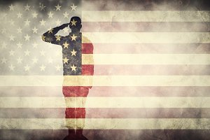 Double exposure of saluting soldier.