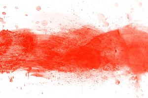 Red splashes of paint on canvas.