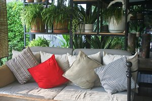 Pillow on sofa bed at outdoor