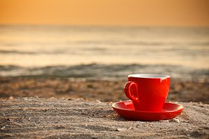 Coffee cup on beach