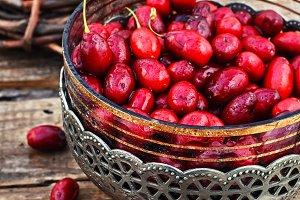 Vase with ripe cornelian cherry