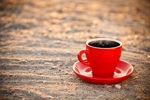 Coffee cup on sand