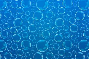 A lot of soap bubbles on blue
