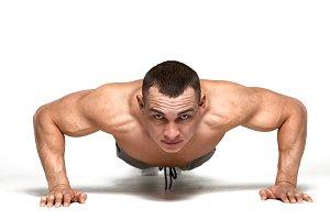 Muscle man making push ups